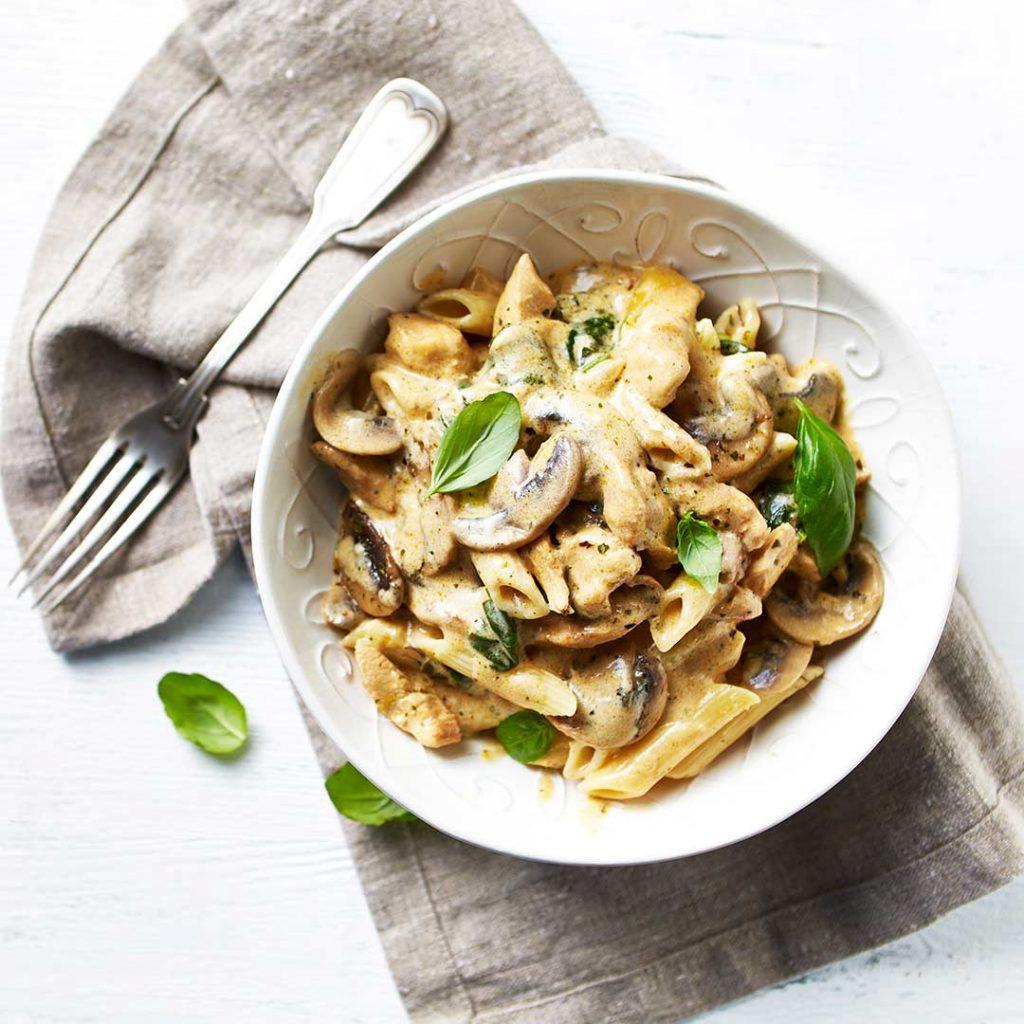 Romige pasta met champignon en spinazie